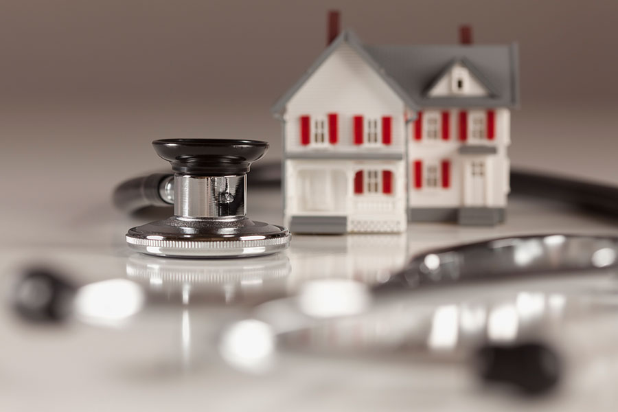 stethoscope surrounding mini house